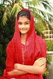 Smart Punjabi teenage girl. A smart Indian girl in her traditional red dress Stock Photo