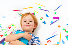 Smart pupil with a book and school office supplies Stock Images