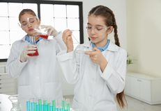 Smart pupils making experiment in class. Smart pupils making experiment in chemistry class royalty free stock photos