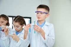Smart pupils making experiment. In chemistry class royalty free stock photos