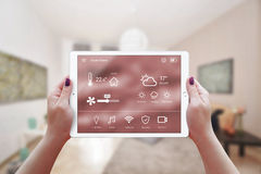 Smart remote home control app in woman hand Royalty Free Stock Photography