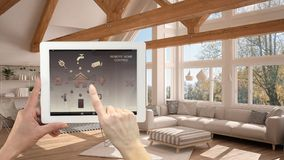 Smart remote home control system on a digital tablet. Device with app icons. Interior of modern living room in the background, arc