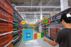 Smart retail with augmented and virtual reality technology concept, Customer use ar and vr glasses to search a daily deal stock photography