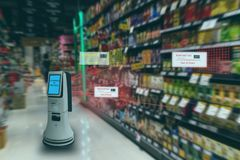 Smart retail concept, robot service use for check the data of or Stores that stock goods on shelves with easily-viewed barcode and. Prices or photo compared stock photos