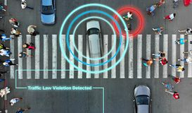 Smart robotic road control technology concept. Aerial from drone. Violation of traffic rules. The car passes on a high speed red light through a pedestrian stock photo