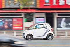 Smart rushes through the city center, Wenzhou, China. WENZHOU-CHINA-NOV. 19, 2014. Smart rushes trough city center. According chief executive Annette Winkler Stock Photo