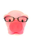 Smart Savings. A pink piggy bank with a pair of specs (glasses) isolated on white background Royalty Free Stock Image
