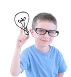 Smart School Boy with Light Bulb. A young boy is holding a drawing of a light bulb and wearing glasses against a white isolated background and looks smart with Stock Photography