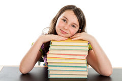 Smart school girl with stack of books Stock Photography