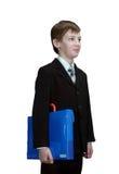Smart schoolboy med mappen Arkivfoton