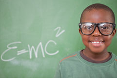 Smart schoolboy posing. In front of a blackboard stock images