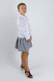 Smart schoolgirl. Cute schoolgirl standing in the studio Stock Photo