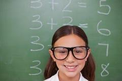 Smart schoolgirl posing Stock Images