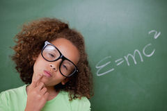 Smart schoolgirl thinking royalty free stock image