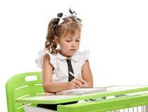 Smart schoolgirl writing Royalty Free Stock Image
