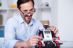 Smart scientist working on a robot production Stock Image