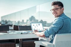 Smart self employed guy smiling while working outdoors Royalty Free Stock Photo