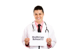 Smart smiling health care professional with a sign that says health care reform Royalty Free Stock Images