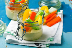 Smart snacking pack veggies dip together in a jar Stock Photo