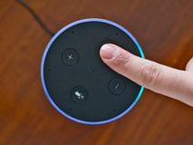 Smart speaker top view artificial intelligence assistant voice control blue ring. Finger stock images