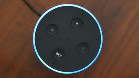 Smart speaker top view artificial intelligence assistant voice control blue ring button activation stock video footage