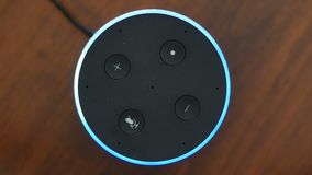 Smart speaker top view artificial intelligence assistant voice control blue ring stock footage