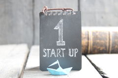 Smart start up, success concept, text and paper boat Stock Photography
