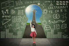 Smart student with keyhole and doodles Stock Image