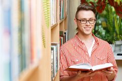 Smart student in a library Stock Photos
