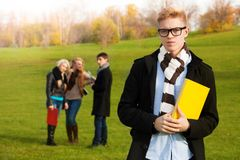 Smart student in park Royalty Free Stock Photo