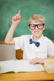 Smart student raising a hand. At the elementary school Stock Photography