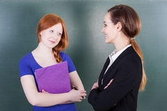 Smart student and teacher Stock Images