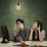 Smart students thinking a bright idea Royalty Free Stock Photography