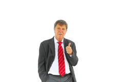 Smart succesful business man with red tie and black suit Stock Image