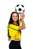 Smart supporting woman holding football Stock Photography