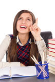 Smart teenager at desk having a brilliant idea Stock Photography