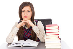 Smart teenager at desk having a brilliant idea Royalty Free Stock Images