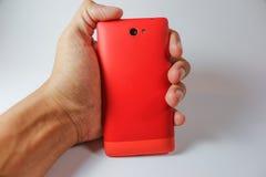 Smart telefon för hållande orage Arkivfoton