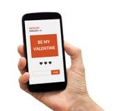 Smart telefon för handinnehav med begrepp för dag för valentin` s på skärmen Royaltyfria Foton