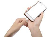 Smart telefon i fall att och laddande kabel royaltyfri fotografi