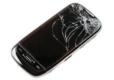 Smart telefon med den spruckna brutna skärmen som isoleras över vita Backg Royaltyfri Bild