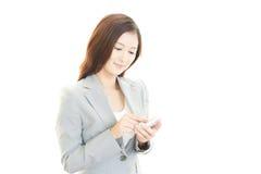Smart telefon med kvinnan Arkivbild