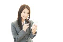 Smart telefon med kvinnan royaltyfria bilder