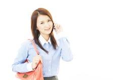 Smart telefon med kvinnan royaltyfri foto