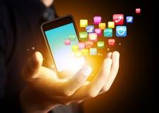 Smart telefon med molnet av applikationen Arkivfoto