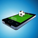 Smart telefon, mobiltelefon med fotbollfotboll Royaltyfri Fotografi