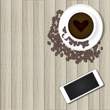 Smart telefon och varmt kaffe Arkivbild