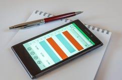 Smart telefon, Pen And Notepad Royaltyfria Bilder