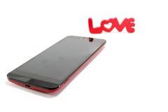 Smart telefon som isoleras på vit bakgrund: med förälskelseord Royaltyfria Foton
