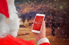 Smart telefon som omges med julpynt Plats för bästa sikt Fotografering för Bildbyråer